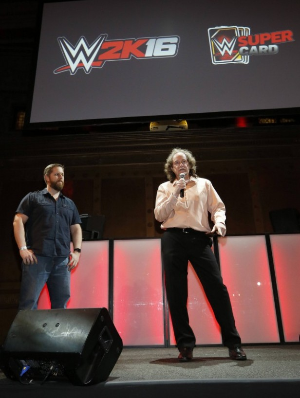 WWE 2K16 Executive Producer Mark Little looks on as Co-Studio Head Harley Howe of Cat Daddy Games, maker of WWE SuperCard, gives opening remarks at the WWE 2K SummerSlam Kickoff in New York, N.Y., Thursday, August 20, 2015. (Photo by Stuart Ramson/Invision for 2K/AP Images)