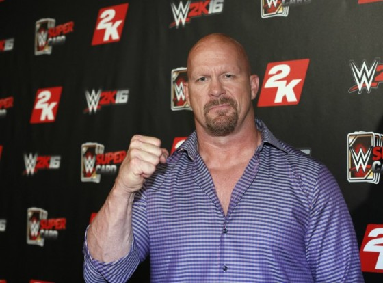 WWE Hall of Famer and WWE 2K16 cover, Superstar Stone Cold Steve Austin arrives on the red carpet at the WWE 2K SummerSlam Kickoff in New York, N.Y., Thursday, August 20, 2015. (Photo by Stuart Ramson/Invision for 2K/AP Images)