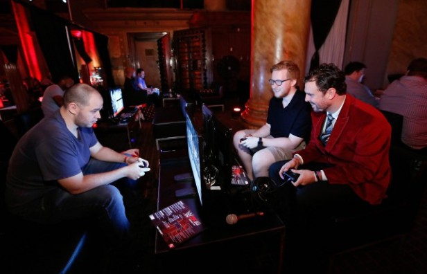 Media representatives pictured from left to right, Victor Ferreira, James Darnell and Anthony Whitver, try out WWE 2K16 at demo stations during the WWE 2K SummerSlam Kickoff in New York, N.Y., Thursday, August 20, 2015. (Photo by Stuart Ramson/Invision for 2K/AP Images)