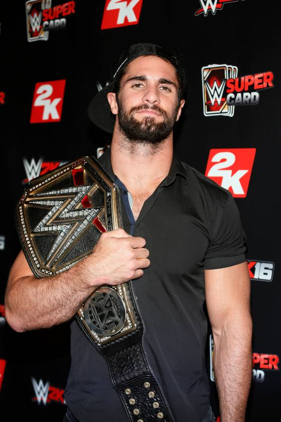 WWE World Heavyweight Champion Seth Rollins poses with his championship title at the WWE 2K SummerSlam Kickoff in New York, N.Y., Thursday, August 20, 2015. (Photo by Stuart Ramson/Invision for 2K/AP Images)