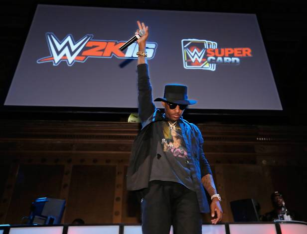 Hip-hop artist Fabolous performs for an energetic crowd at the WWE 2K SummerSlam Kickoff in New York, N.Y., Thursday, August 20, 2015. (Photo by Stuart Ramson/Invision for 2K/AP Images)